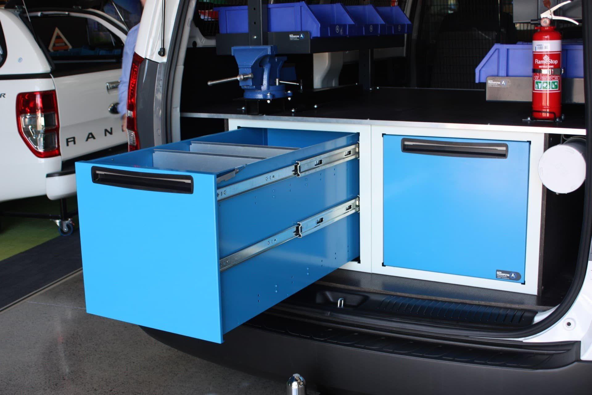 Bin drawer storage system in vehicle
