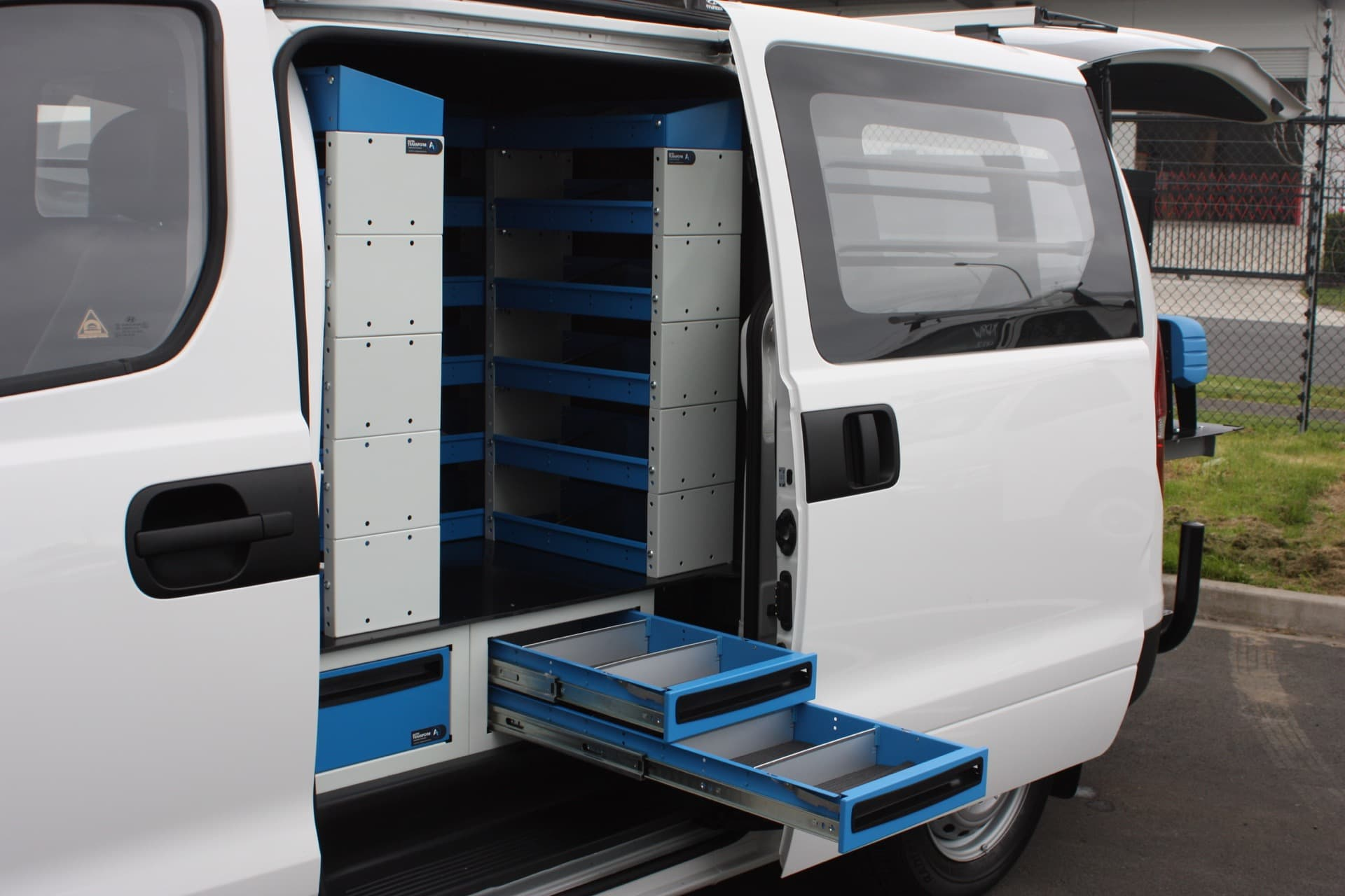 Custom vehicle interior with tool drawers