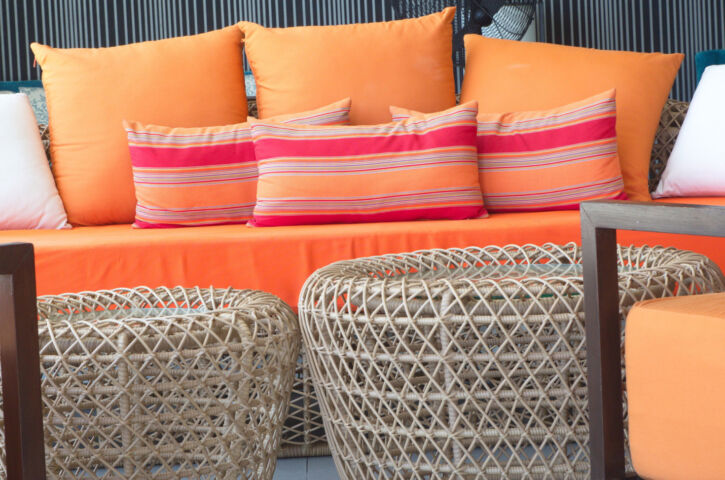 orange sofa with the colorful pillows x