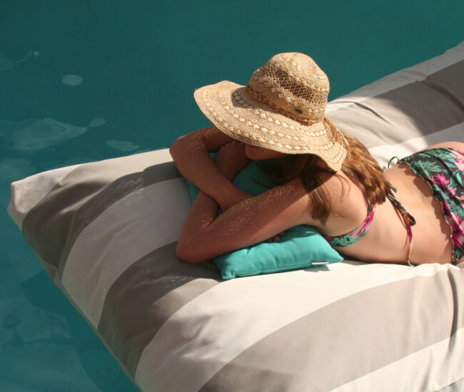Woman Lying on a Floating Outdoor Beanbag