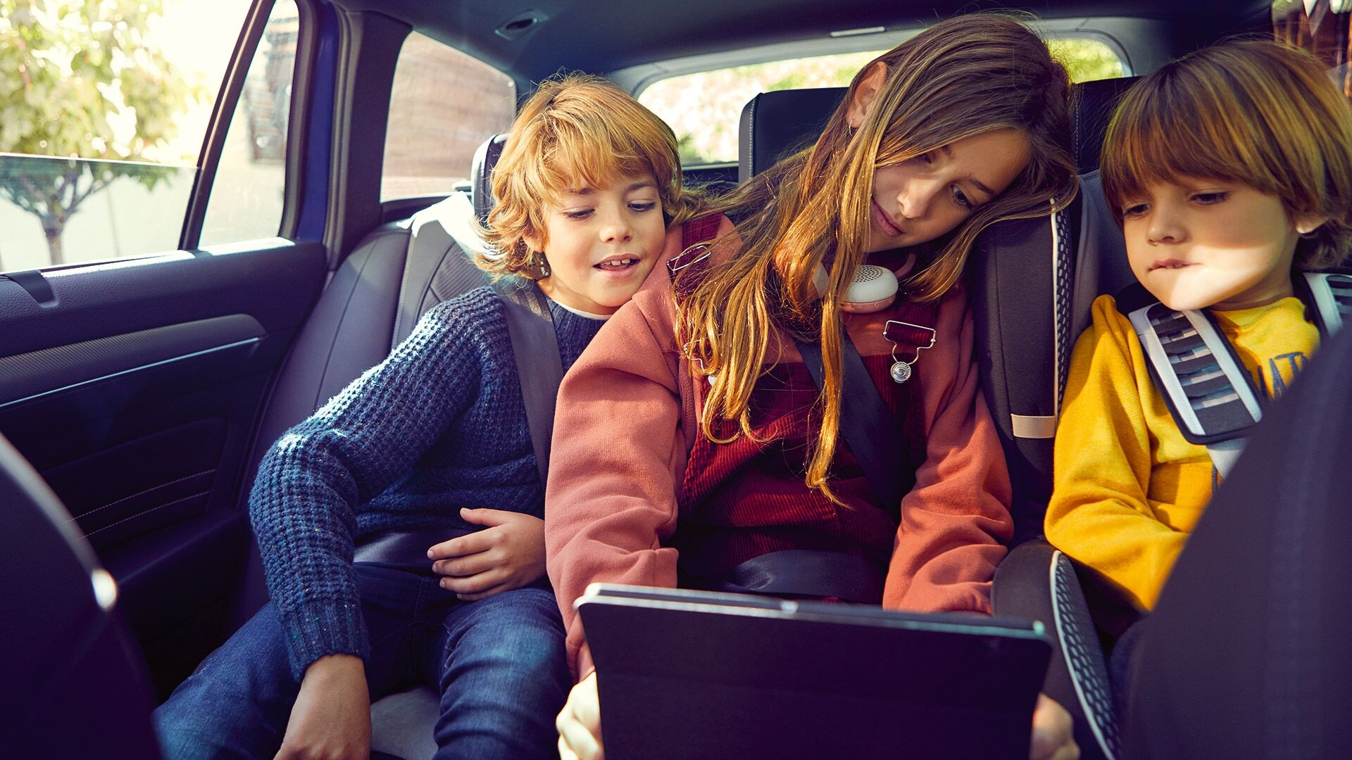 passat interior with kids looking at tablet