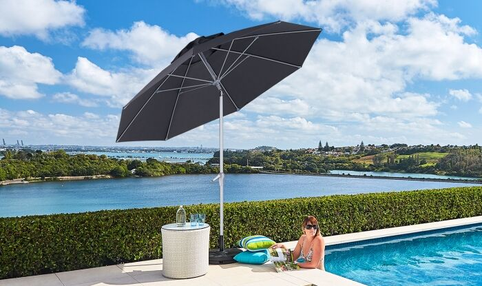 Tilting Black Umbrella by Pool
