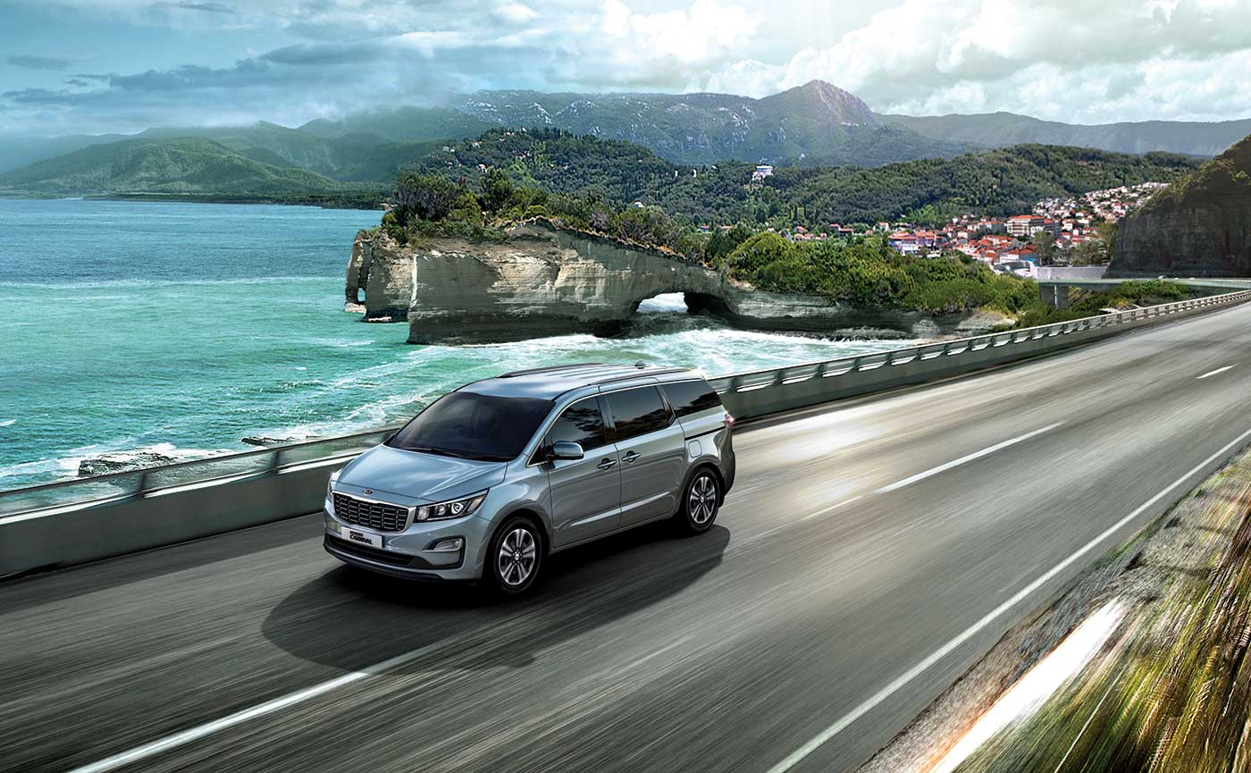 kia carnival highway by water